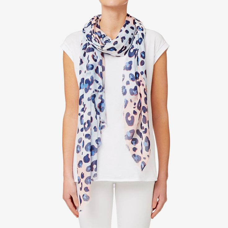 In this season's coveted ocelot print, this scarf features a beautiful pastel palette for a subtle touch of style. Made from polyester for a light finish.