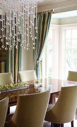 chandelier, upholstered chairs, blue, green, aqua, light filled,