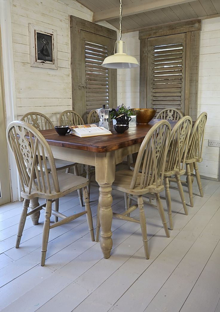 We've painted this large dining set in Annie Sloan Country Grey over Old White, creating a charming rustic farmhouse look. There's plenty of room for all the family with 8 wheelback chairs and large table top