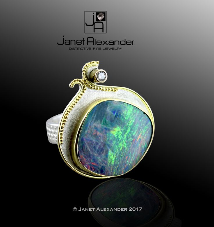 Opal set in 18k gold with 18k gold granulation and 2.7mm Diamond (H-J, I3) .08ct. Ring is Argentium Sterling Silver. Size 8. The Opal has a rating of AAA displaying color ranges from Blues, Greens, Red, and Violet.