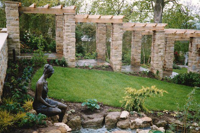 Evolving Spaces Landscape Designs LTD - A tiered Oak and Stone pillared pergola.