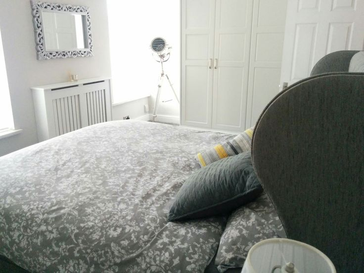 Our lovely grey bedroom!  bed is from elephant beds, Cardiff. The mirror from Argos, wardrobes are ikea pax but built into the wall using MDF and painted white to match the skirtings. lamp is from BHS (a present from last Christmas), radiator cover from B&Q