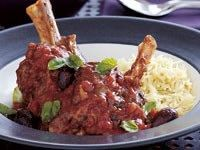Slow-roasted lamb shanks with tomato and olives