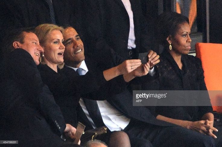 US President Barack Obama, and British Prime Minister David Cameron, and Denmark's Prime Minister Helle Thorning Schmidt pose for a selfie (Photo by Roberto Schmidt) | #selfie