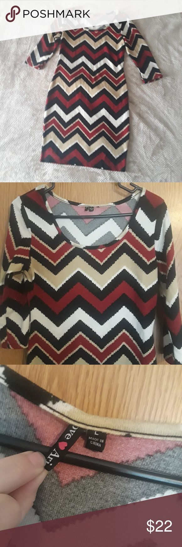 Chevron print dress Love Ari Black, white, brick, khaki  Sweater dress Size: Large 95% Polyester, 5% Spandex   -Fitted; mid length; half length sleeves; super soft.   This item is in very good used condition. There is some slight piling; no tears, snags or stains. Love Ari Dresses Midi