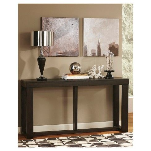 Drawing from the beauty of clean-lined mid-century design, this sofa table feels right at home in today's modern spaces. Oil-rubbed distressing on the decadent finish adds a layer of beauty and character.   Signature Design by Ashley is a registered trademark of Ashley Furniture Industries, Inc.