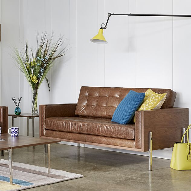 Inspired by the classic Mid-Century style of exclusive London clubs, this handsome Marlburg range of chairs and sofas by Steijer create a strong and striking visual presence. The graphic lines of the beautifully finished walnut veneer frame contrasts perfectly with the soft buttoned back upholstery. And the distinct steel legs create an almost suspended look to the structure. All pieces in the range are designed so that they look great as a stand-alone statement or as a magnificent…