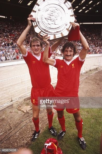 Liverpool players Phil Thompson and Terry McDermott hold the FA Charity Shield aloft after a 10 win over West Ham at Wembley Stadium on August 9 1980 in London England
