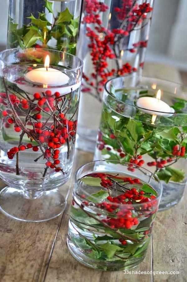 clear glass vases, berries and greenery and floating candles Christmas Centerpiece
