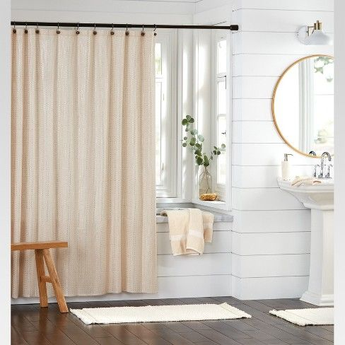 Let your bathroom shine by hanging up the Metallic Shower Curtain from Threshold™ above your clawfoot tub or shower. This cream shower curtain features a subtle pattern of rose gold dots with a metallic finish for a luxurious look. Installation is easy thanks to a buttonhole top — all you need is a set of curtain hooks or rings. Coordinate with matching decorative pieces in rose gold or metallic hues, and finish off your decor with greenery to brighten up the space.
