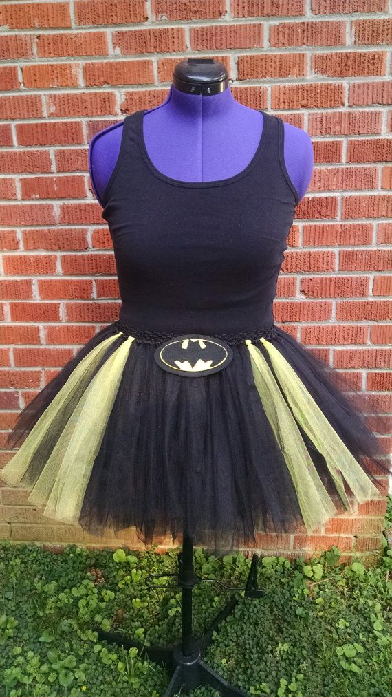 This batman tutu is made of soft tulle on a comfortable elastic band featuring a removable batman insignia. As always, if you have any ideas to make this your own, just send us a conversation. We love custom orders!  Length: This tutu is medium in length,16 - 20 inches long.If you would like longer, send a custom order request for pricing.  If you are looking for a Shorter tutu, please see the below listing https://www.etsy.com/listing/242329938/adult-batman-tutu-batm...