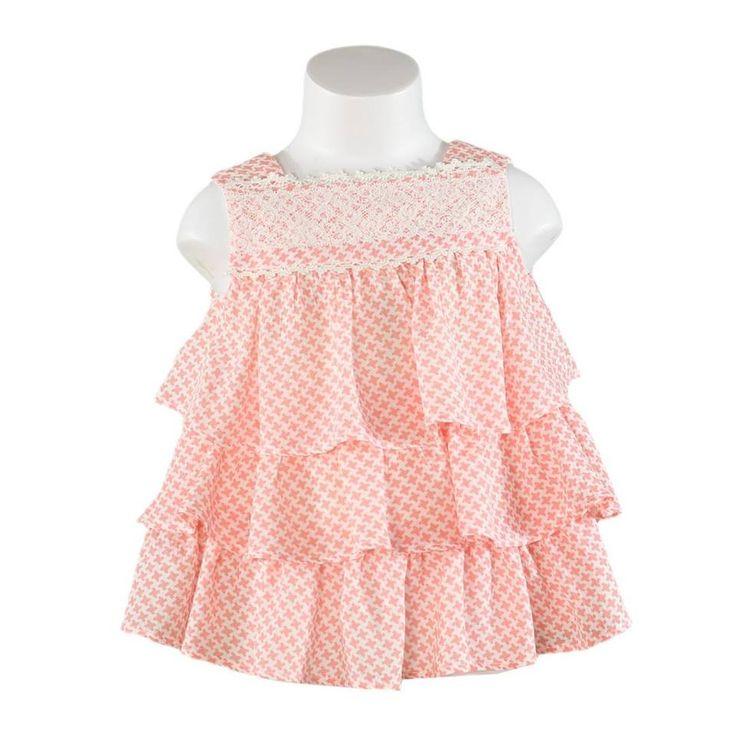 Vaatteita tytöille. Miranda textilesin mekko tytölle lohenpunaisilla ja valkoisilla kuvioilla sekä pitsisomiste yläosassa. Vauvanvaatteita ja lastenvaatteita www.nellikki.fi