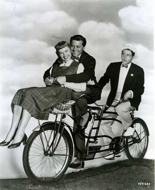 Doris Day, Gordon MacRae and Jack Smith ride a bike.