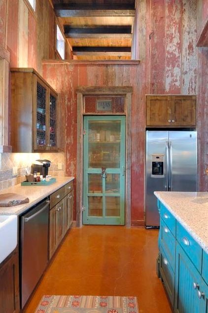 Colorful Pantry Doors- The turquoise on this vintage screened pantry door feels fresh but still ties in to the kitchen's reclaimed, vintage look.