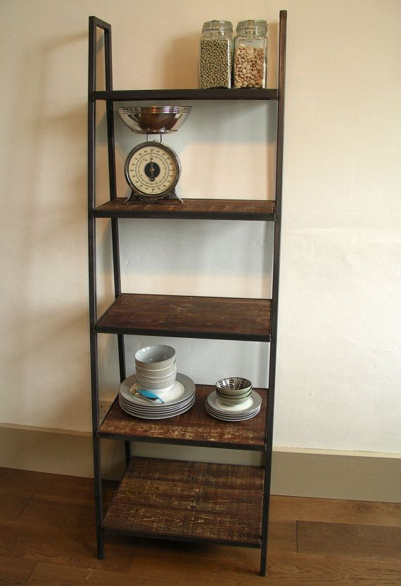 Beautiful industrial style free standing ladder shelf, ideal for display and storage at home or retail setting. Dark steel box section frame with dark distressed wood shelves set within a steel frame give the shelving a lovely heavy duty uncomplicated feel, typical of the industrial