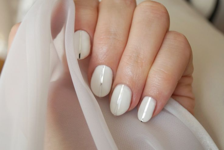Minimal white manicure with silver stripes by vena-styl