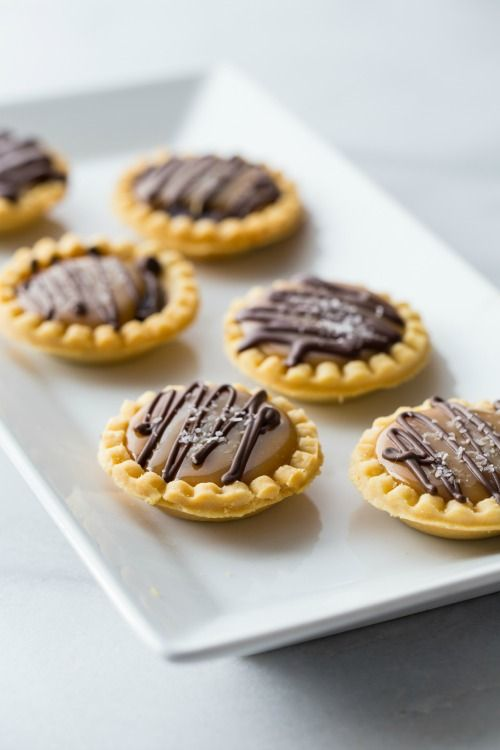 Mini Salted Caramel Chocolate Pies are tiny bites of complete and total holiday win. Think of them as dessert hors d'oeuvres! Pass 'em around.
