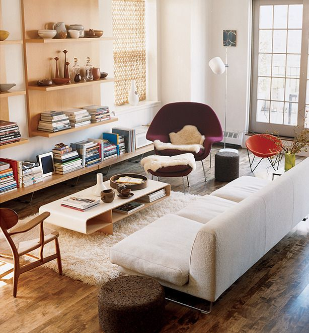 Living room: Love the floating shelf panels.