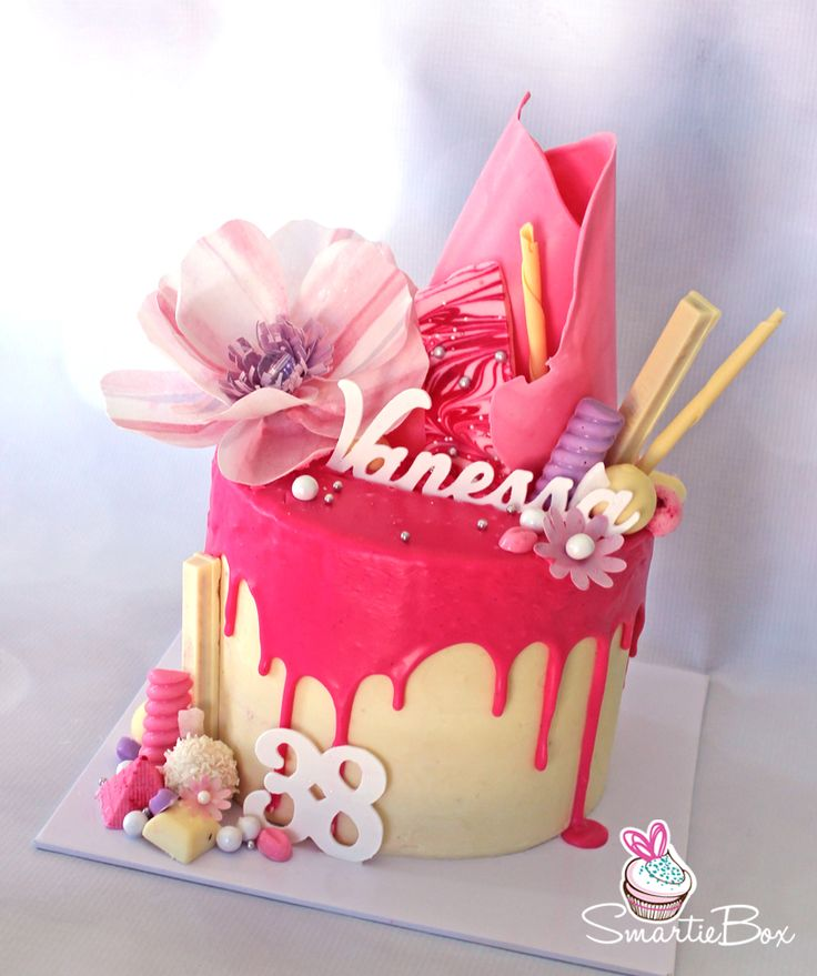 Pink drizzle cake with edible wafer paper flower - SmartieBox Cake Studio