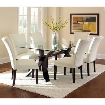 """The Berkley Dining Collection is modern art in furniture form, with sharp angles creating a visually balanced uniquely modern look. The Berkley deep espresso dining table base and clear glass top are a perfect pairing, creating a 42"""" x 72"""" x 30"""" dining room table that seats six comfortably...."""