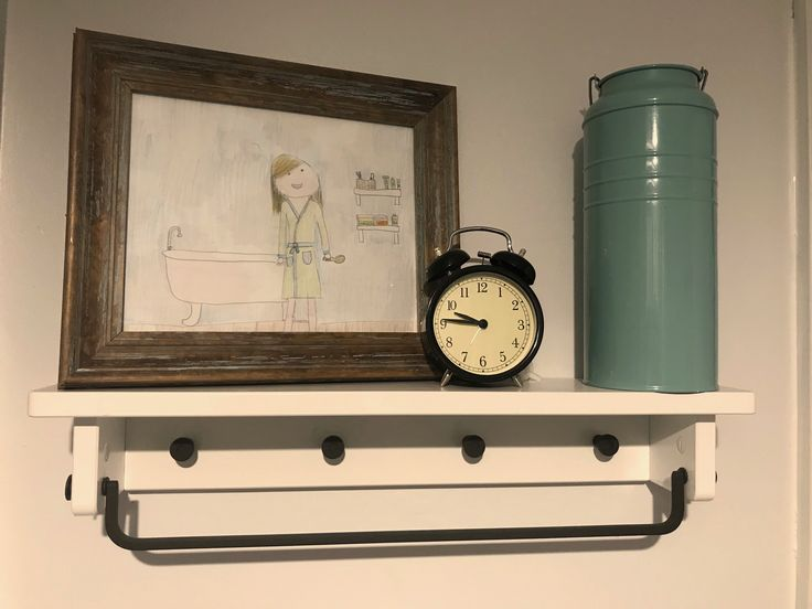 Shelf, clock and tin by IKEA. Art by Ellie age 13.