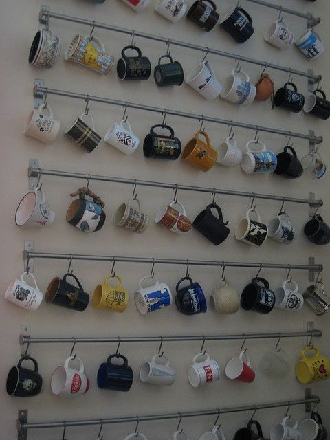 Displaying mugs using a kitchen rail and hooks from Ikea. @Erica Cerulo Broten why do I imagine your house having this?