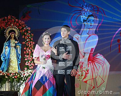 Filipina actress, Miss Kris Bernal and Aljur are models at a Flores de Mayo event held in Manila.