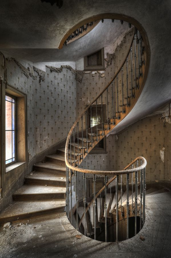 A magnificent staircase in an abandoned farmhouse in Belgium.  What must it have looked like in its prime? It's beautiful,...