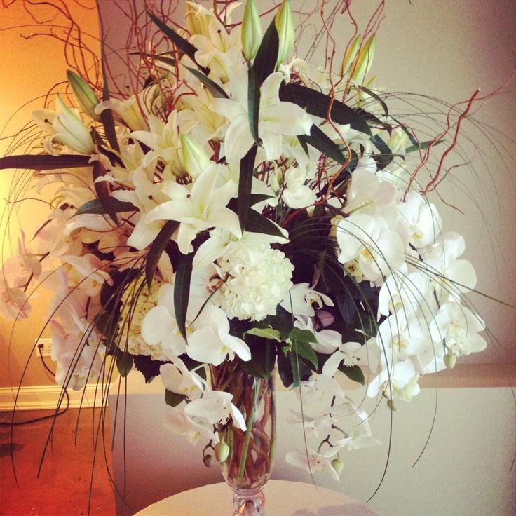 Sympathy arrangement with phalaenopsis orchids