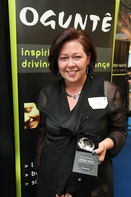 Donna Morton, winner of the People's Choice Award 2012, pictured with her award for work with First Power    See more photos over on Flickr: http://www.flickr.com/photos/ogunte/#