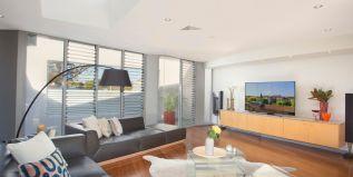 Open plan living area, sky light, district views