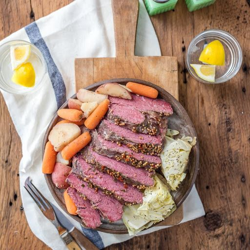 Traditional Slow Cooker Corned Beef And Cabbage With Beef Brisket, Onions, Red Potato, Baby Carrots, Beef Bouillon, Garlic Cloves, Worcestershire Sauce, Dry Mustard, Cabbage, Caraway Seeds, Beef Broth
