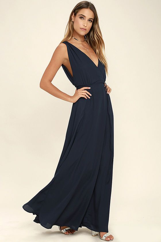 The Strictly Ballroom Navy Blue Maxi Dress is sure to stun at any occasion! Lightweight woven fabric shapes a plunging V-neck and back. A tying waist sits atop a full, wrapping maxi skirt. Hidden back zipper.