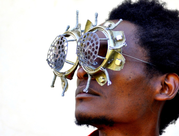 African artist Cyrus Kabiru creates wearable art using found materials that he collects from the streets of Nairobi. He is perhaps best known for his C-STUNNERS, an ongoing work in which Cyrus creates and wears sculptural bifocals. The work sits itself between fashion, wearable art, performance, and one of a kind commodity objects. C-STUNNERS have a certain energy and playfulness that really captures the sensibility and attitude of a youth generation in Nairobi.