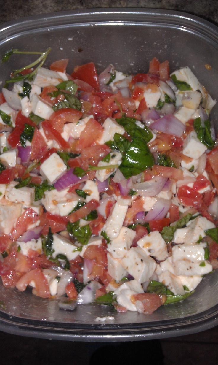 Tomato salad. Mozzarella cheese, basil leaves, red onion, tomatoes, and Greek gazebo room dressing.