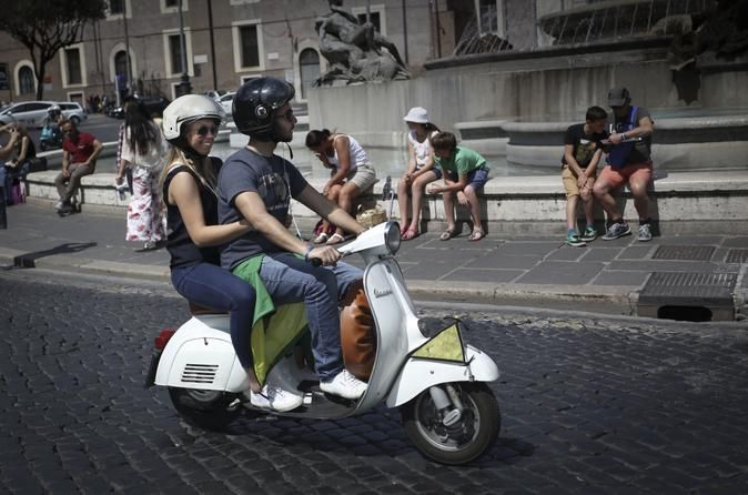 Rome by Vintage Vespa - Classic Rome Tour Looking for a sightseeing to experience, in a short time, Rome highlights, travelling Italian style? An exclusive private Vespa Tour is the solution! Colosseum, Vatican, Trevi Fountain, and the Pantheon are just some of the attractions you'll see along this Tour that includes several ff the beaten path stops, like the historical Appian way, the secret Keyhole or the stunning panorama of the Janiculum Hill. The most Flexible an...