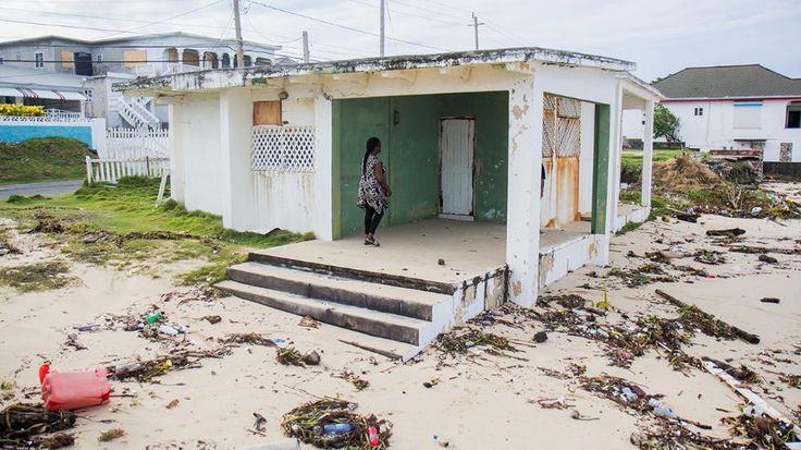 Houses are battened up to prevent and sand from entering homes in Long Bay, Portland in Jamaica after Hurricane Matthew hit the area. (Jik-Reuben Pringle / weather.com)