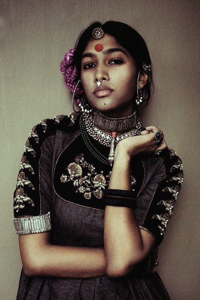 Depicting Indian tribal woman in a designer wear. Description by Pinner Mahua Roy Chowdhury