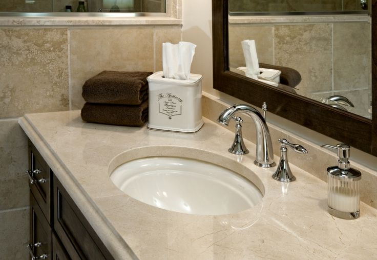 Custom crema marfil marble countertops accent the vanities for Crema marfil bathroom designs