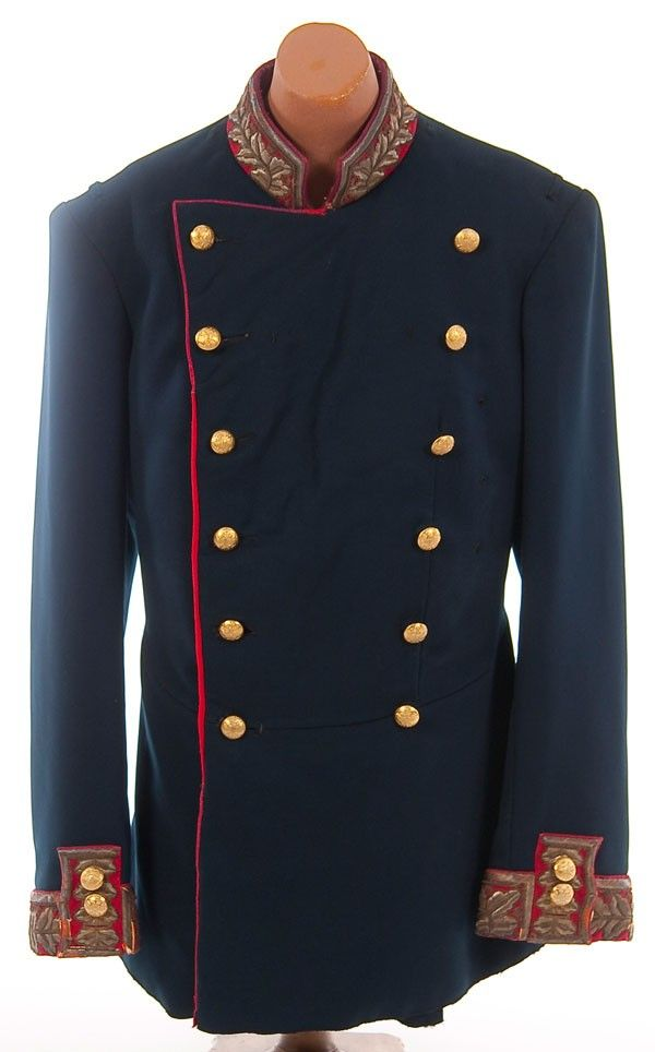 Imperial Russian unassigned General's tunic, circa 1900.  Made of dark blue wool double breasted tunic with red collar, cuffs and piping. Collar and cuffs richly embroidered in a gold bullion oak leaf motif. Left chest with several worked holes for badges or orders, lacks epaulettes. Garment shows some age and service wear. Provenance: Gerard Gorokoff.