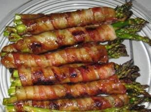 Bacon Wrapped Asparagus  Preheat oven to 400 Divide asparagus into bundes of 3-4 spears Wrap each in a slice of bacon In a saucepan, melt a stick of butter, 1/2 c. brown sugar, 1Tbspn soy sauce, 1/2tsp garlic salt, and 1/4 tsp black pepper and bring to a boil. Pour mix over bundles and bake until bacon looks done.