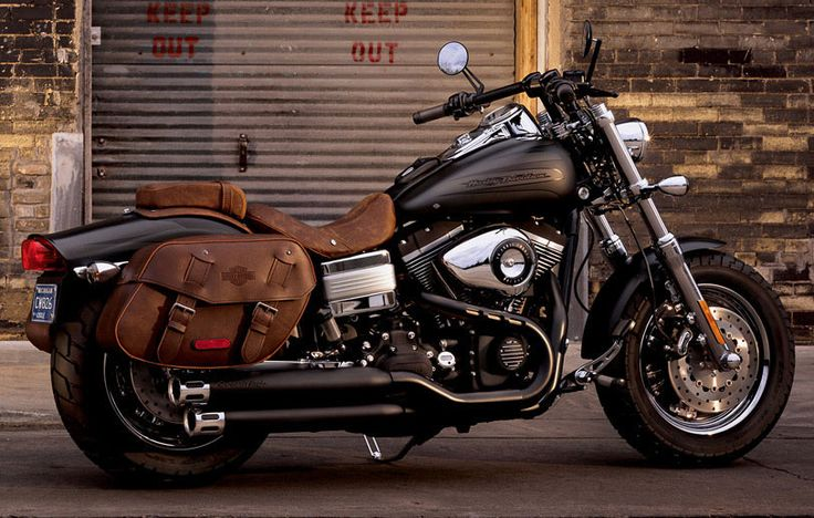 A sturdy brown leather saddlebag ensures that this powerful bike is packed up and ready for the road. | Harley-Davidson 2010 Fat Bob®