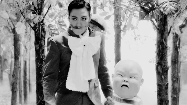 T.O.P - DOOM DADA M/V. 1. Love this song. It fits TOP so well! 2. It was weird to my ears..but I love it!