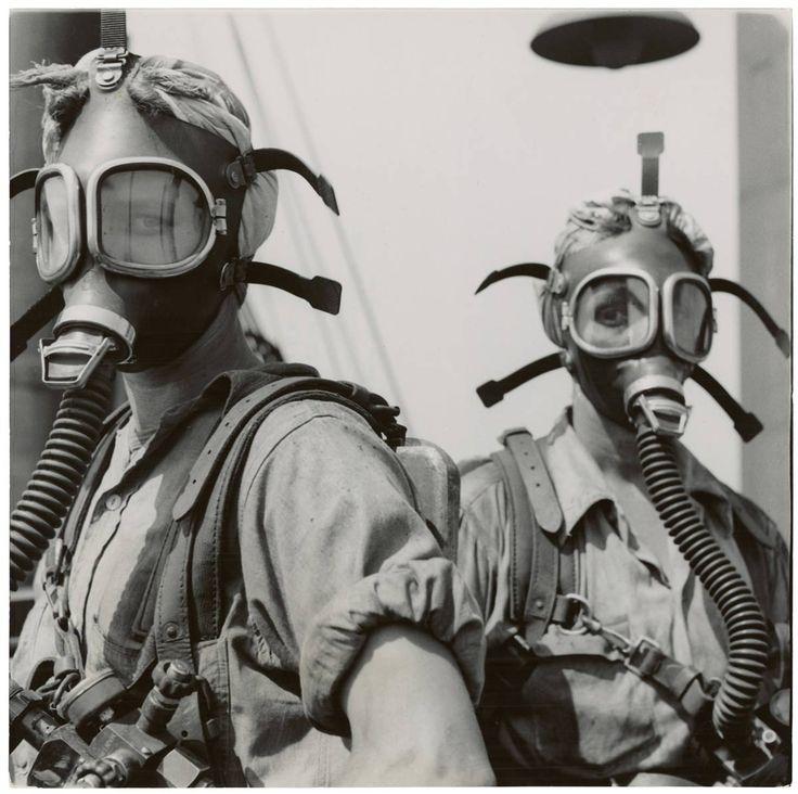 WW2 nurses testing gas masks - 1940s
