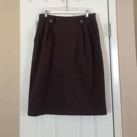 Dolce & Gabana brown skirt Has pockets. Slight pleat in the front. Leopard print lining. Worn once. Great condition. Dolce & Gabbana Skirts