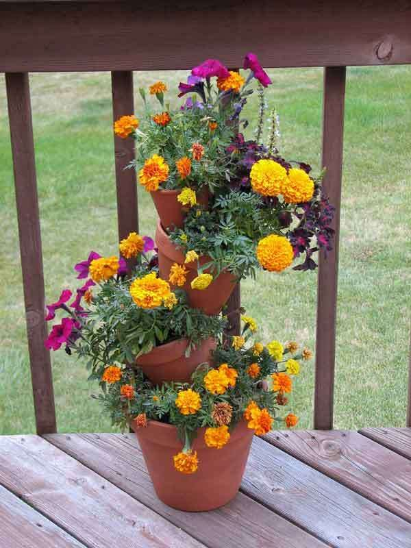 Tiered Planter Clay Pots With Rod Sticking Through Holes