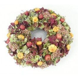 Herfstkrans van Hortensia's op een glazen schaal