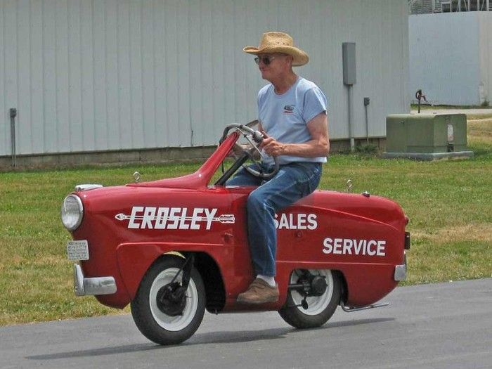 Paul Gorrell created this scooter out of some Yamaha, Crosley, and Subaru parts & a dealership sign.