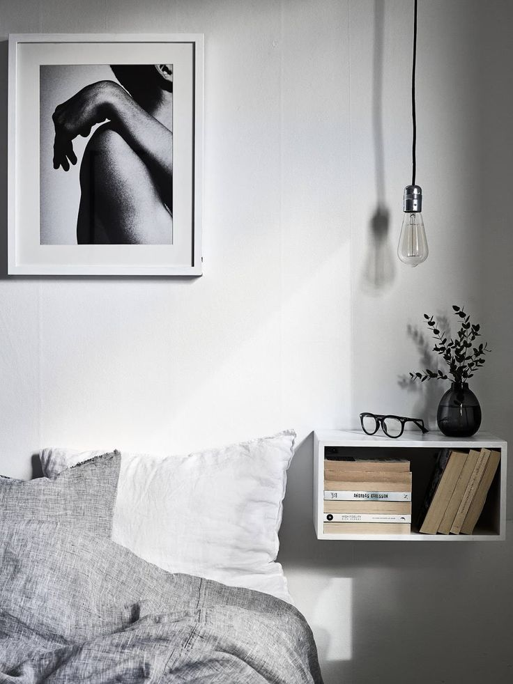 bedroom with floating shelf nightstand and picture