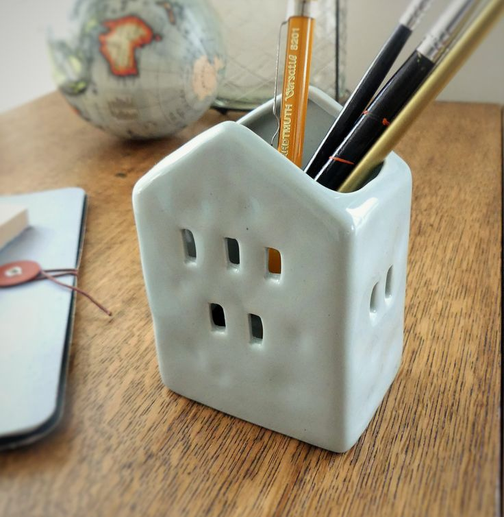 We love this cute little ceramic house pencil holder! Use in your home office, kids rooms or just have it out on display.
